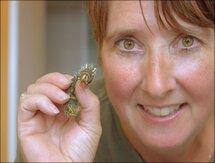 Lori holding rare caterpillar