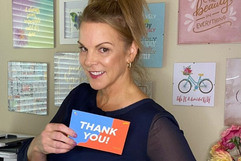 angie strader holding a thank you card