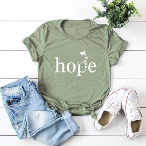Green short sleeved t-shirt with the graphic printed hope and butterflies
