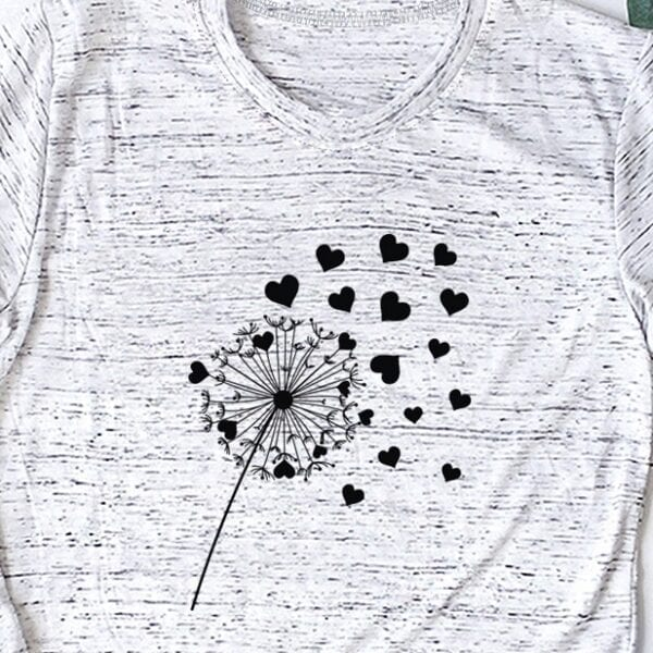 heather white t-shirt printed with a dandelion and hearts