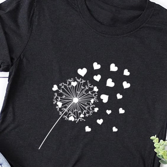 black t-shirt printed with a dandelion and hearts