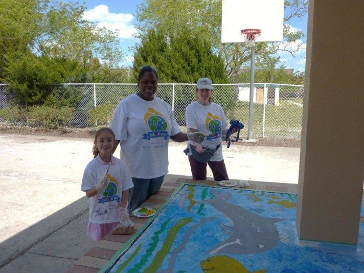 """Sharyn participating in Royal Caribbean """"Give Day"""" painting a mural with Royal staff and next generation"""