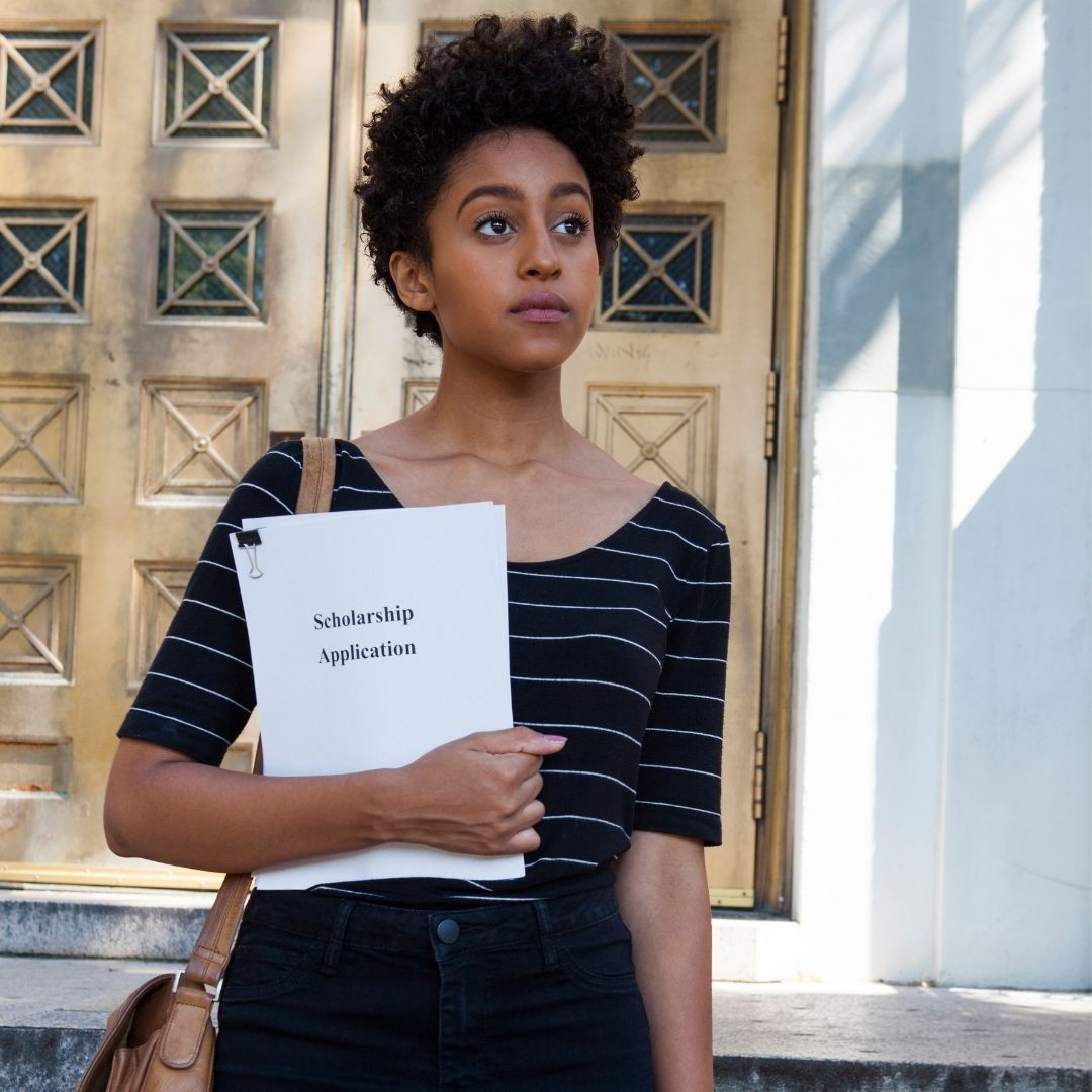 girl holding her scholarship application