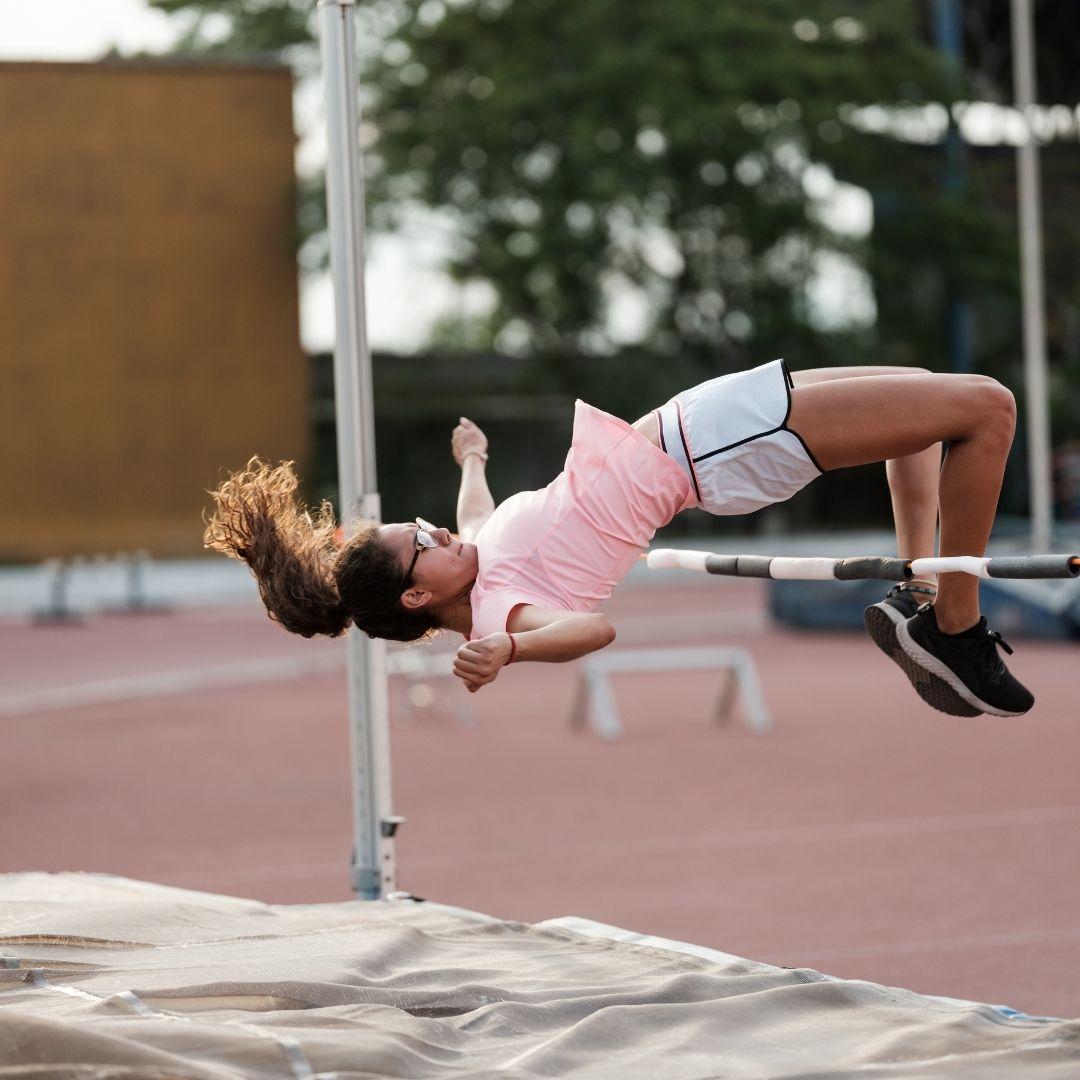 girl jumping the bar