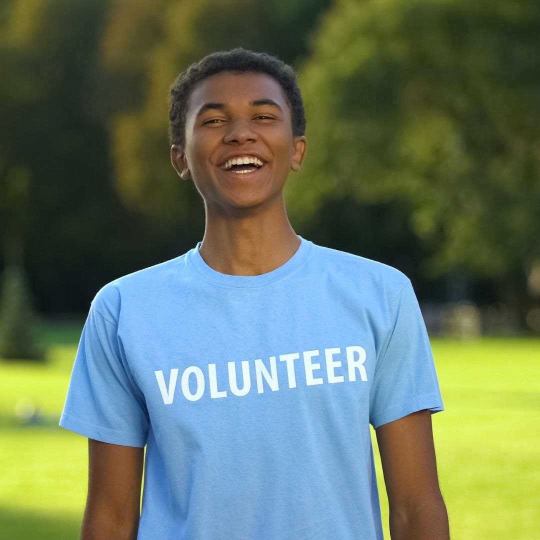 boy student wearing a volunteer t shirt