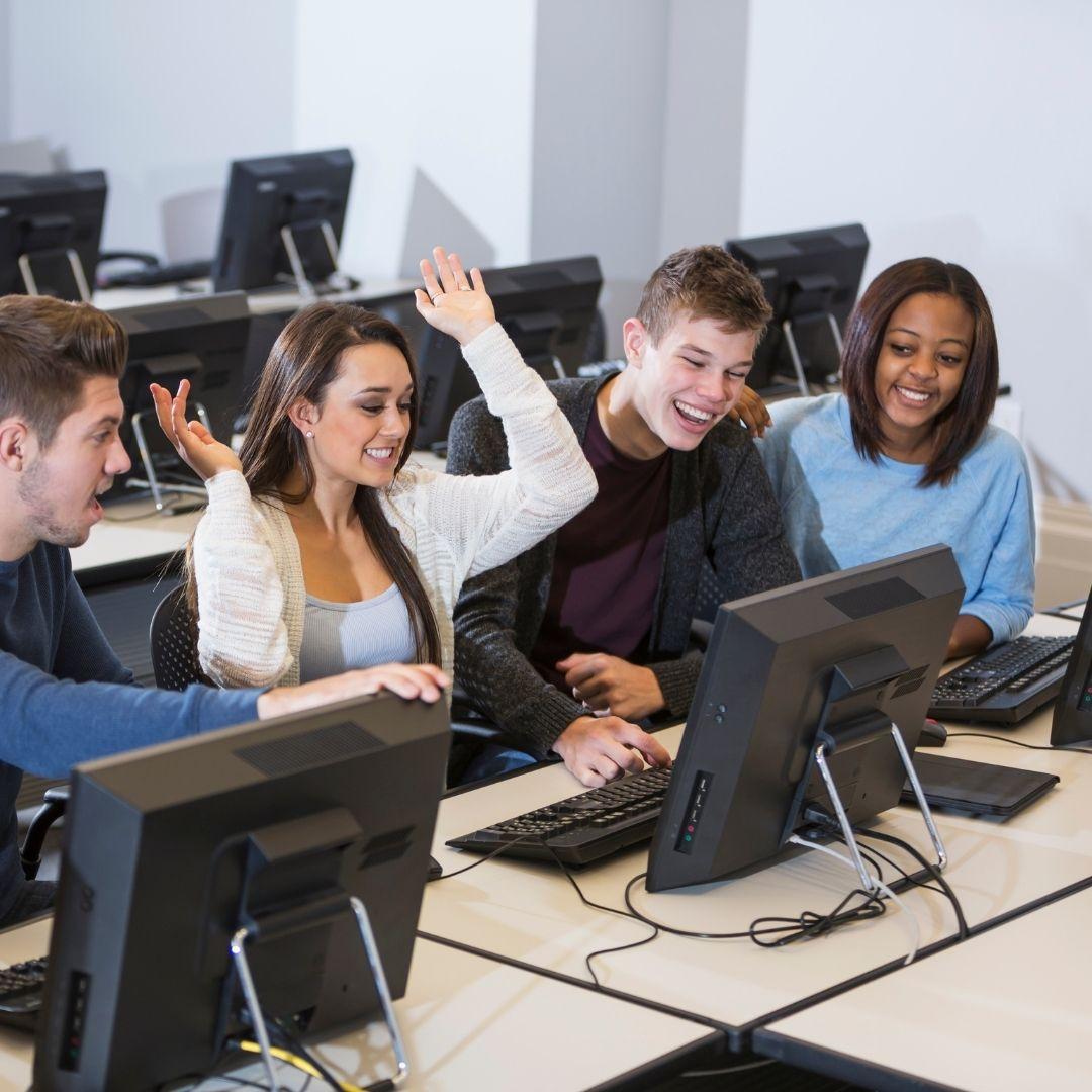4 students enjoying their time at a virtual college fair