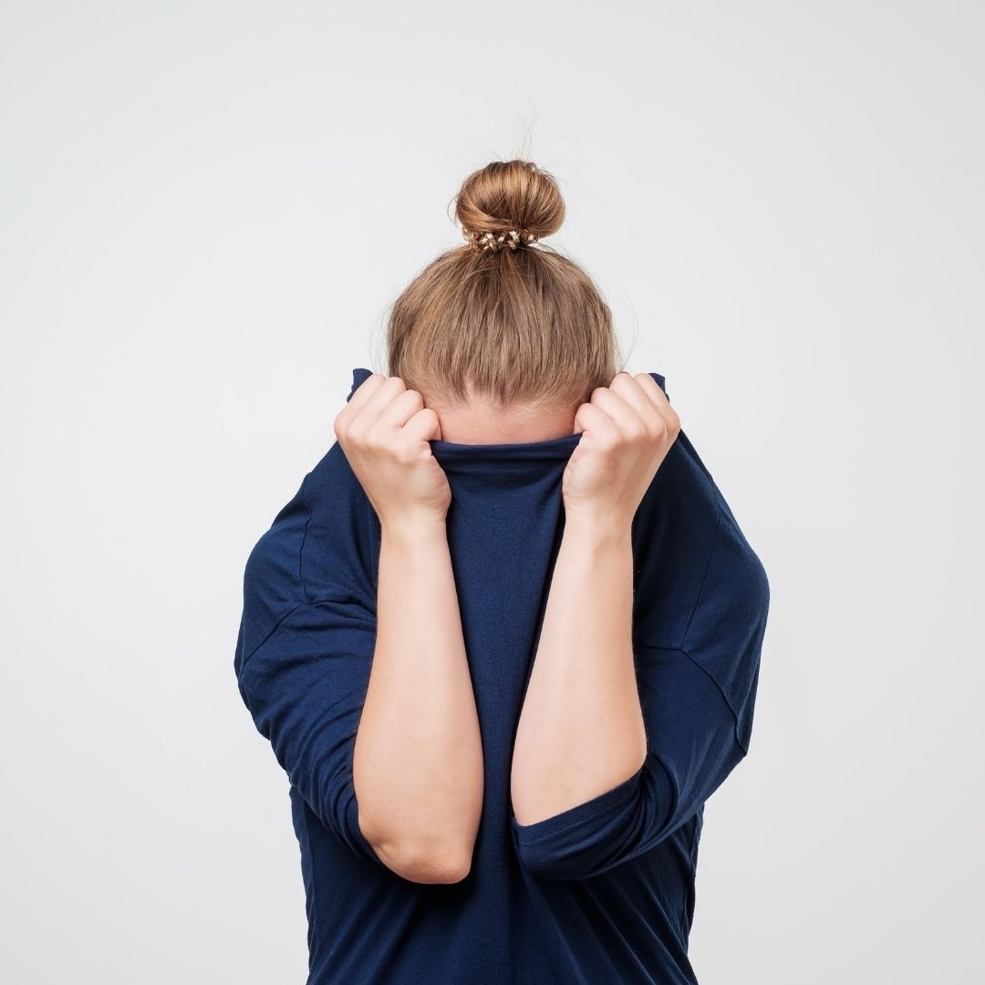 girl covering her face with her blouse