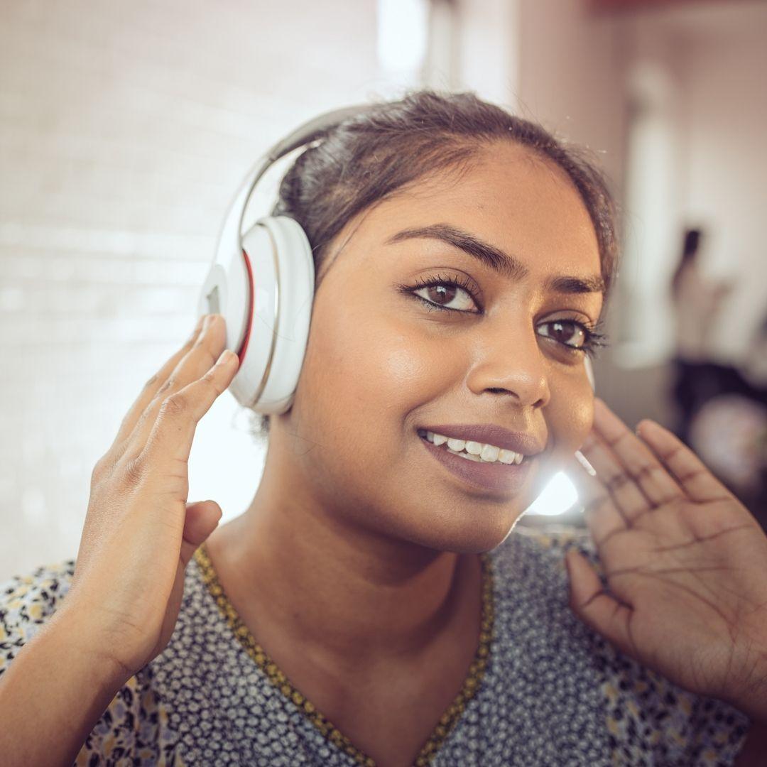 girl listening music in her earphone