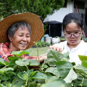 activities that impress colleges like this teen gardening with her grandmother