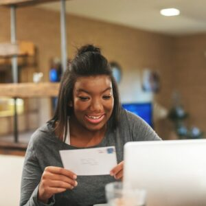 girl student getting her letter for college