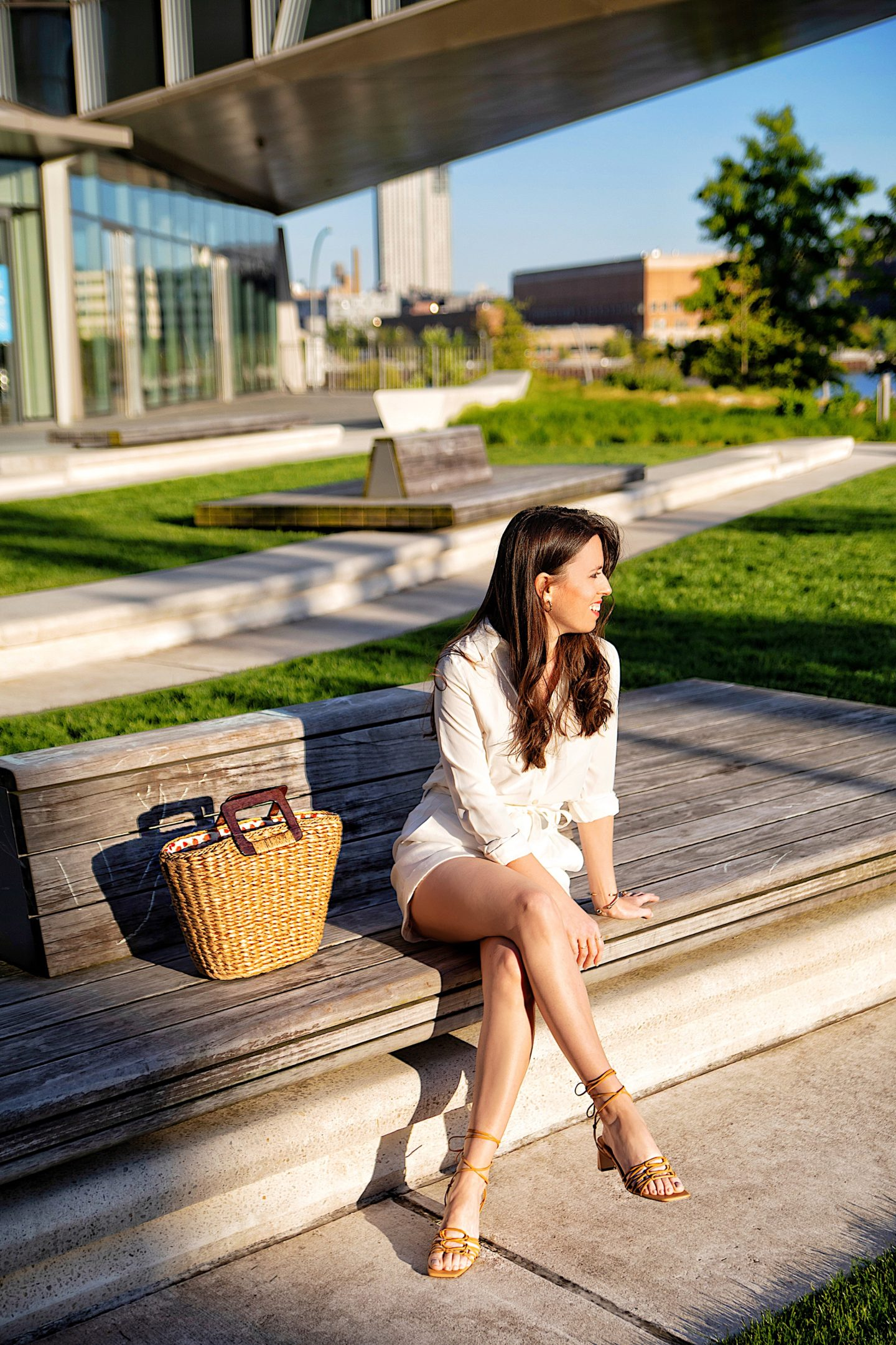 Ana Florentina wearing Ann Taylor lace up sandals and straw bag