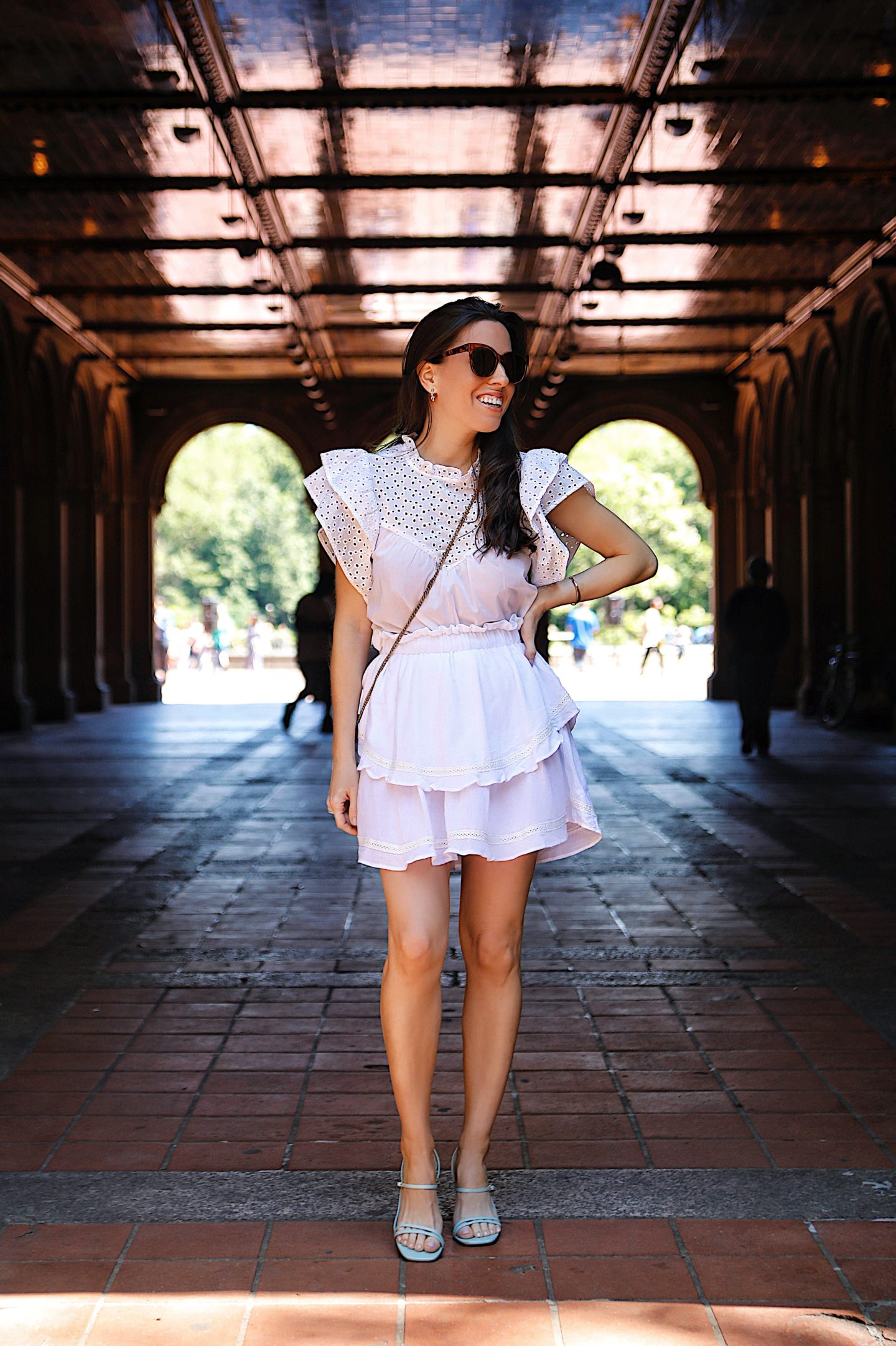 A casual eyelet top paired with a white mini skirt