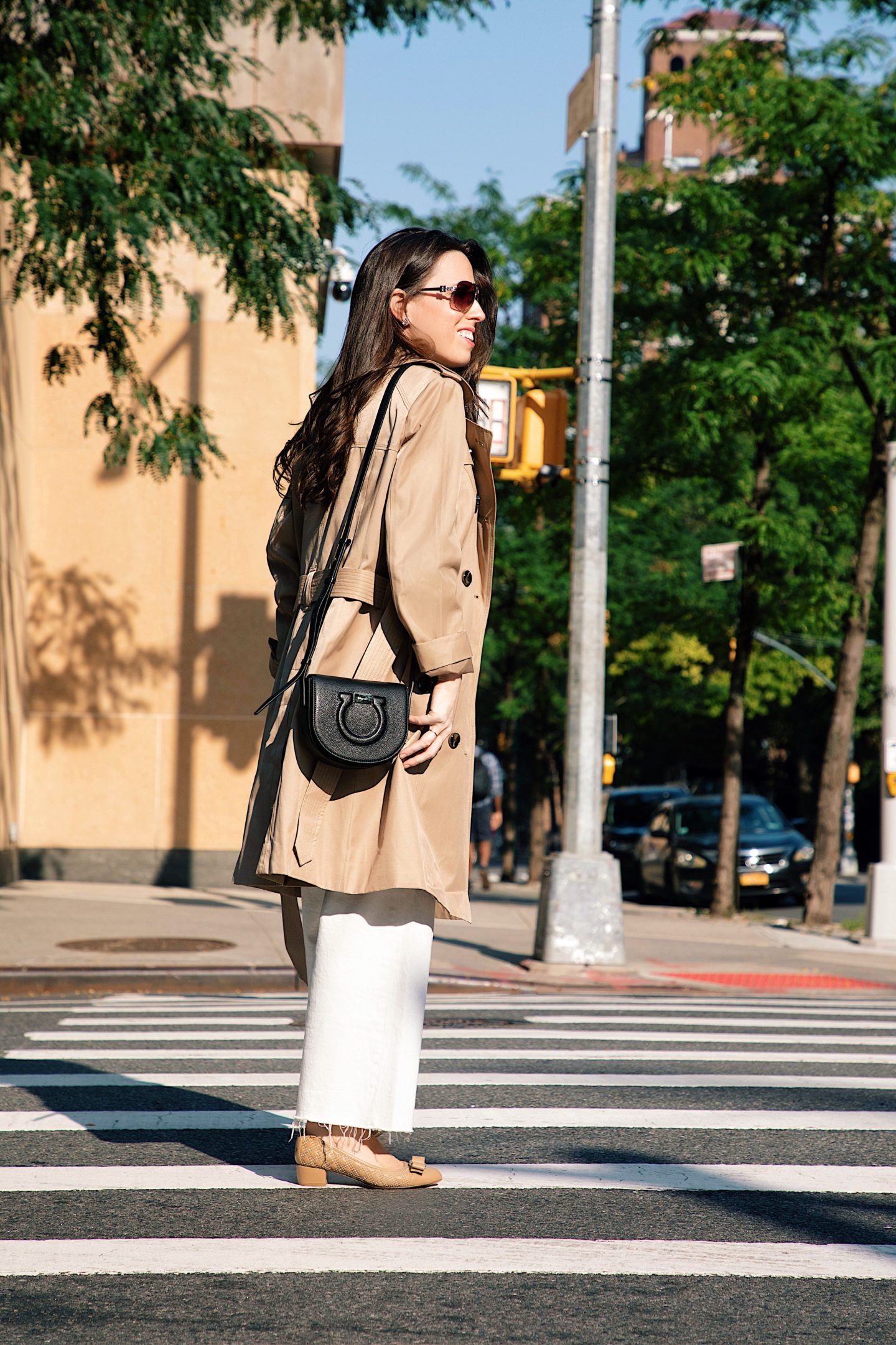Ana Florentina wearing London Fog Trench Coat with white jeans a black top