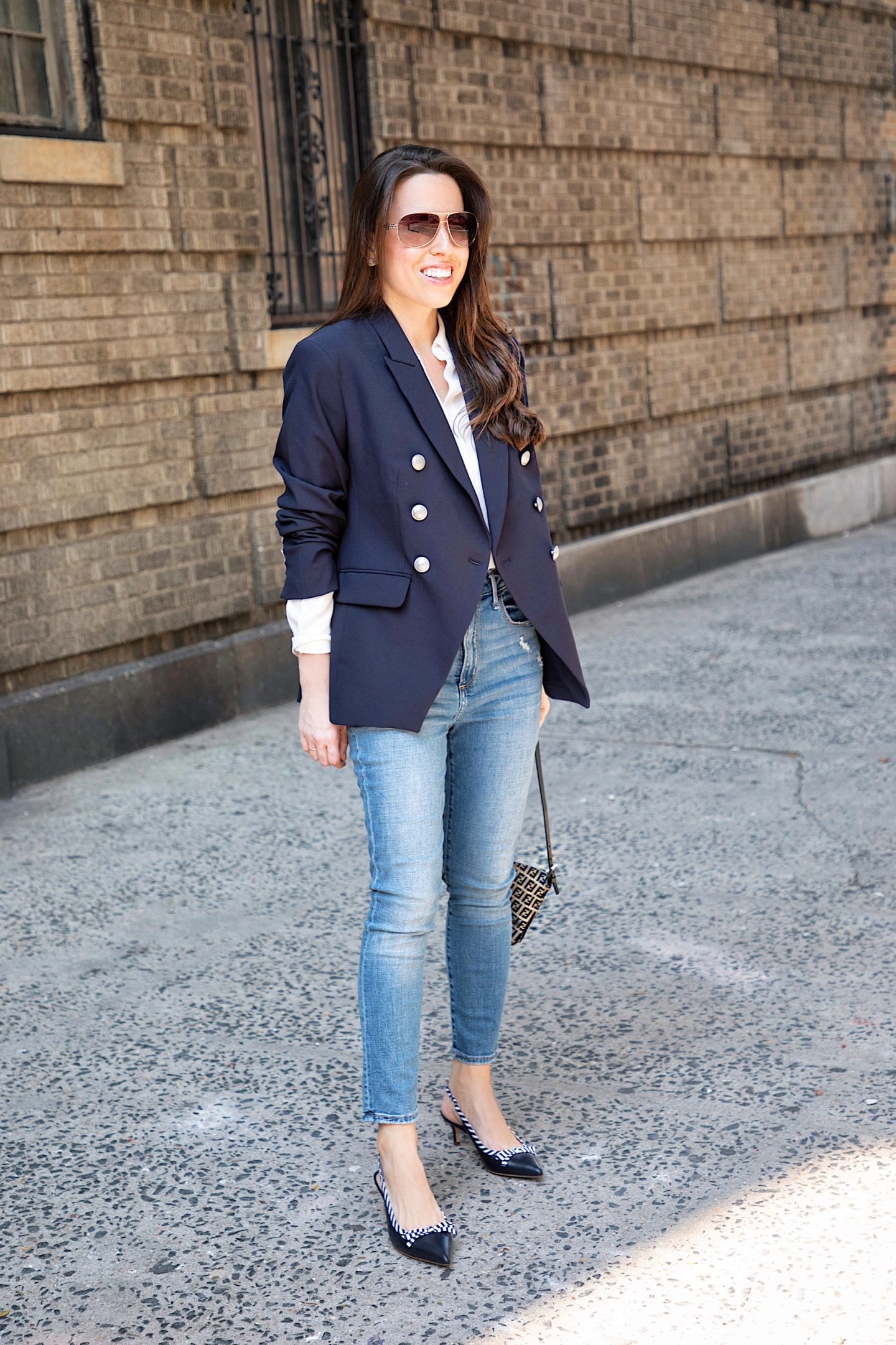 ana florentina wearing a navy blazer with buttons