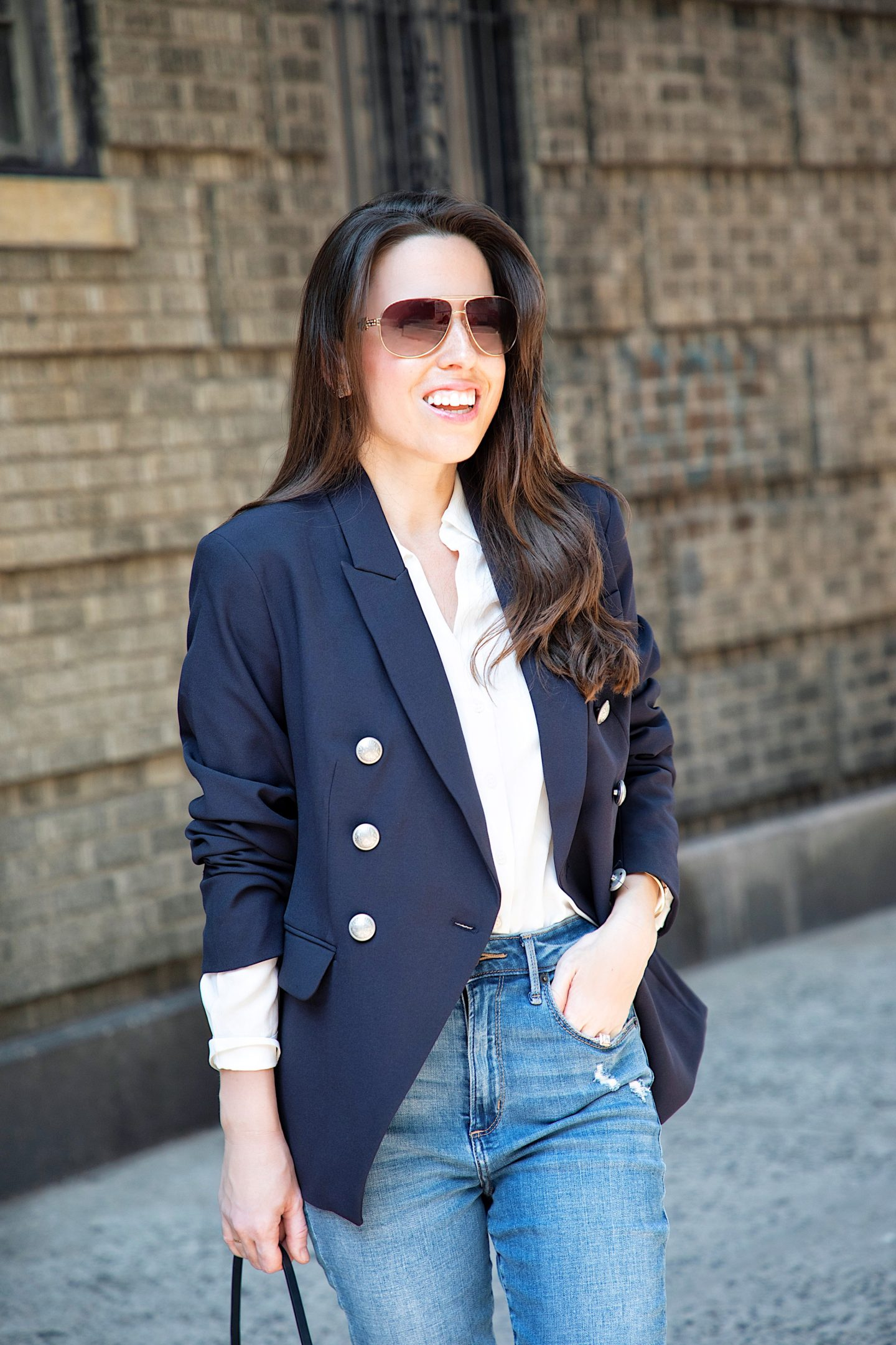 ana florentina wearing navy blazer with buttons