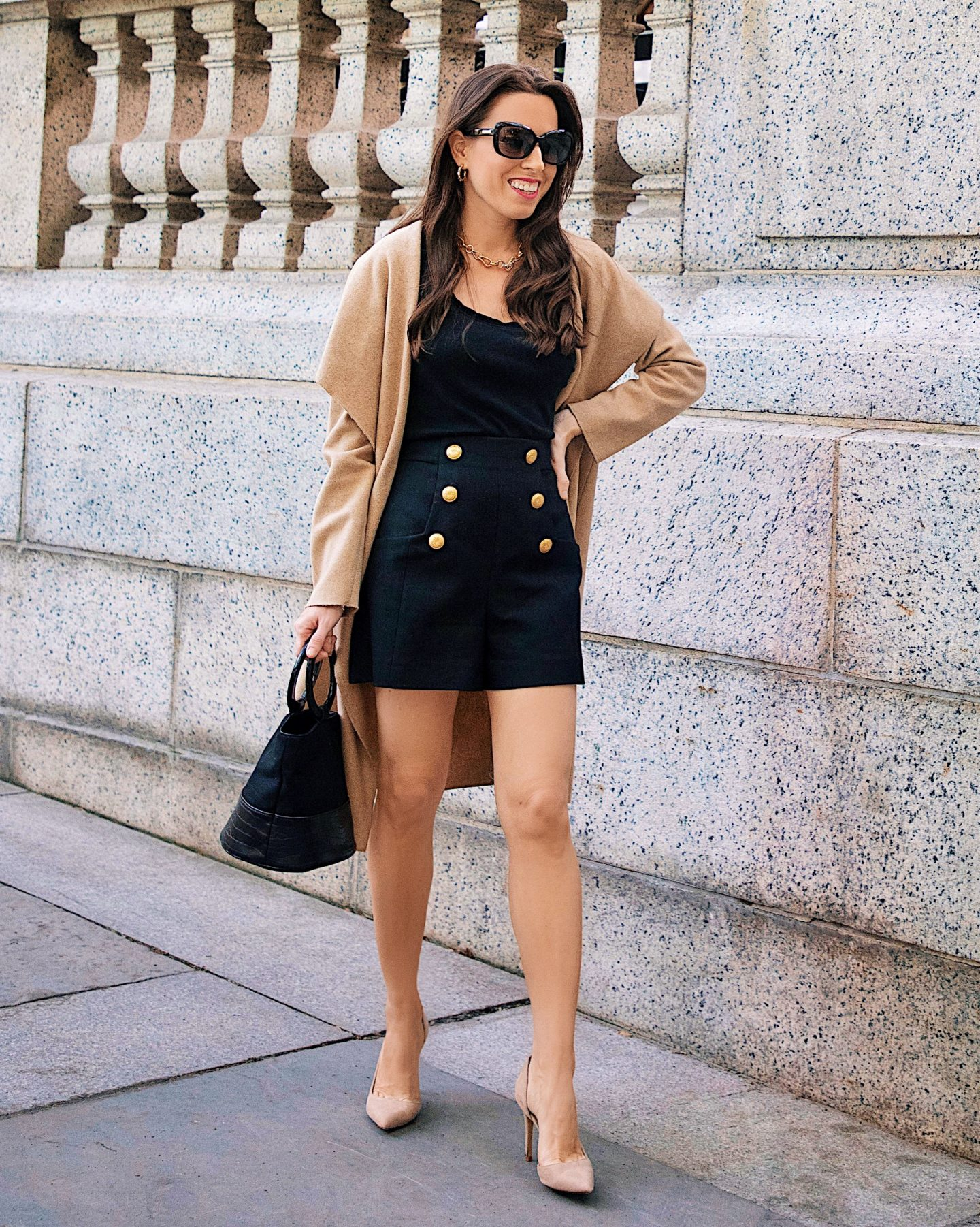 Ana Florentina wearing fall look featuring an open front wool blend coat black shorts with gold buttons