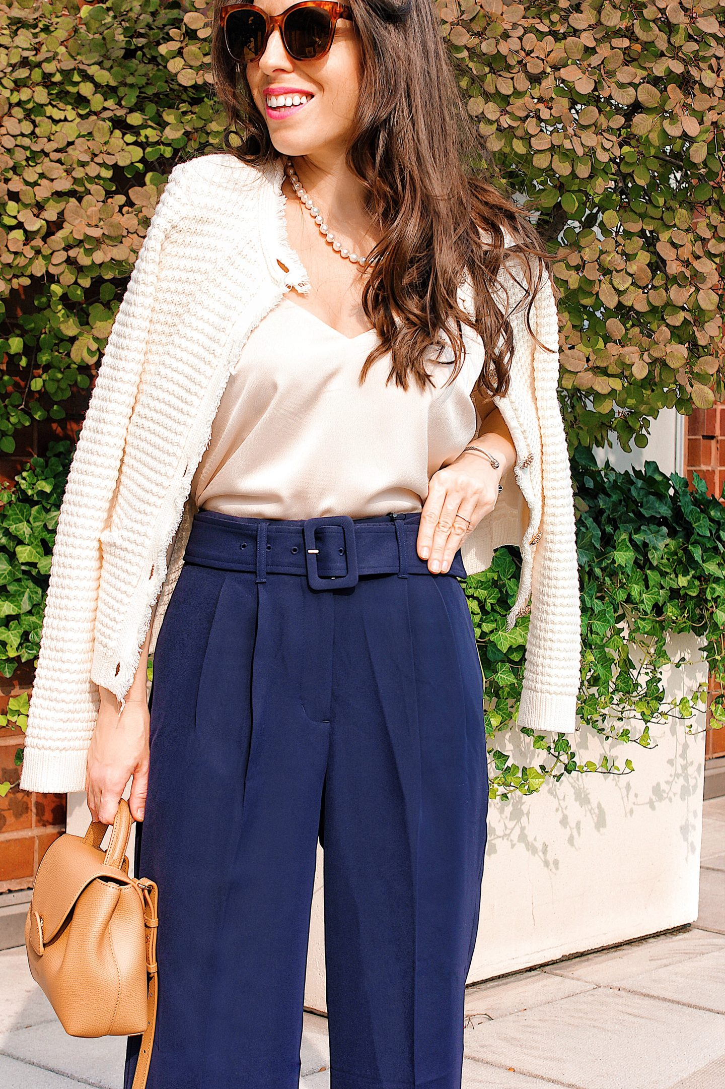 navy pants and sweater jacket