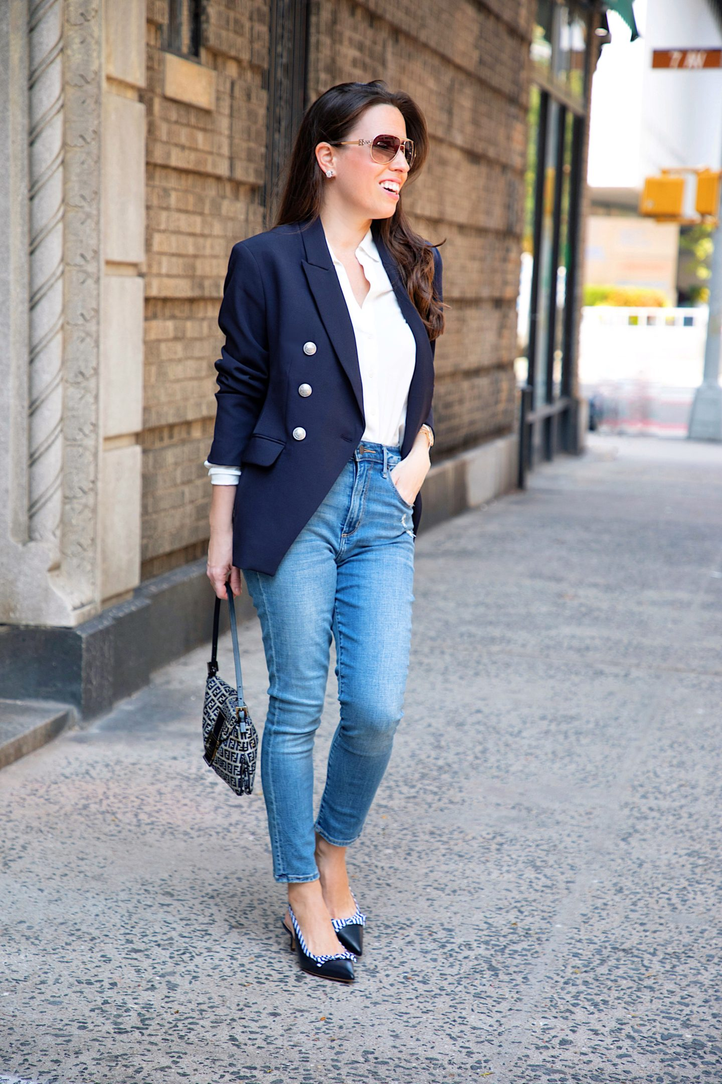 ana florentina wearing a navy blazer