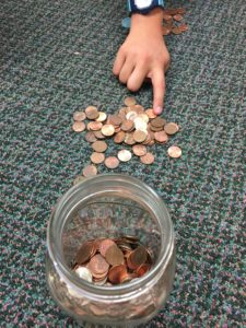 one student plays the penny game