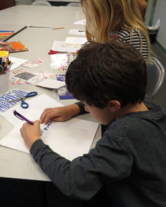 A student places stickers on his story