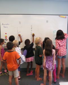 Students playing acrostic races
