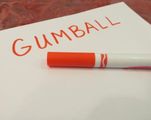 The word gumball written on a piece of paper
