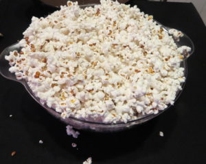 a bowl overflowing with popcorn