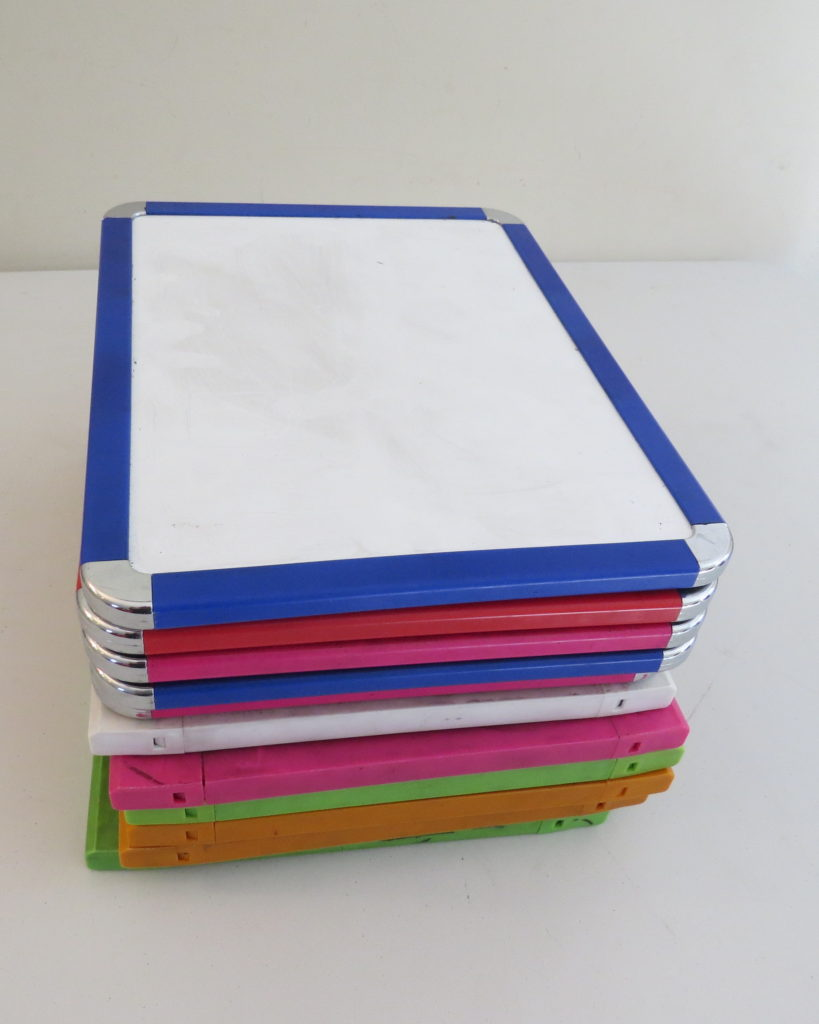 stack of individual whiteboards