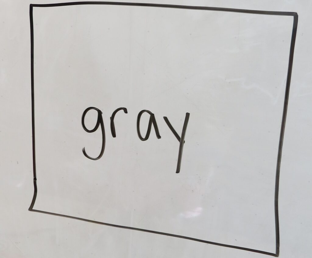 the word 'gray' on a whiteboard