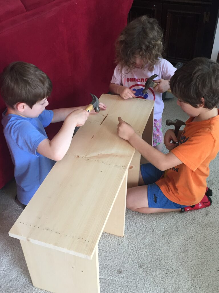 three kids build a 4 tier shelf
