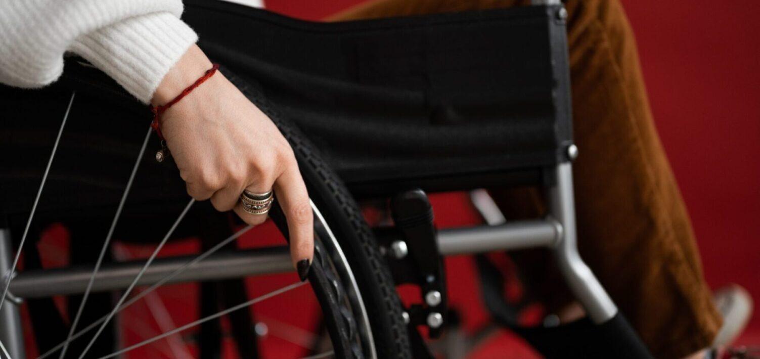 Woman's hand on wheelchair