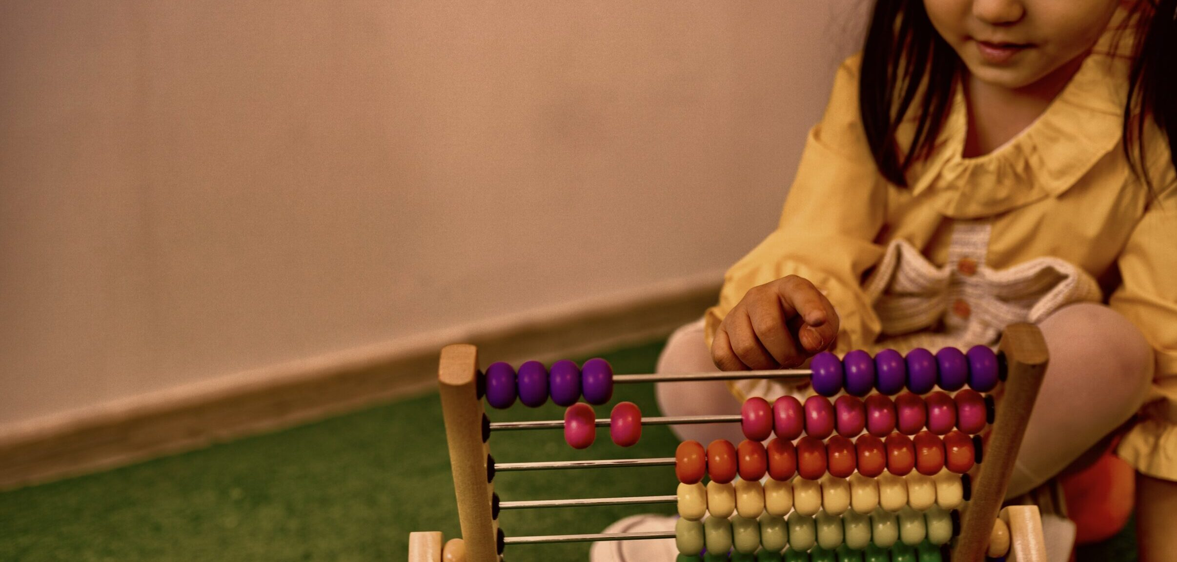 Young girl plays with abacus
