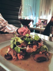 Brick chicken and arugula complimented by a Nebbiolo Italian red wine