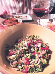 Shaved Brussels sprout salad with pomegranate, hazelnuts, and pecorino cheese