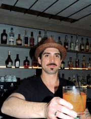 Gregory serves up The Higgins: amber rum, cinnamon infused Italian vermouth, local honey and fresh orange juice