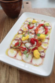 Octopus carpaccio with peppers, cilantro, and pickled cauliflower fleurettes