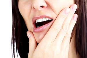 TMJ can cause pain in the jaw, neck, back and through the body.