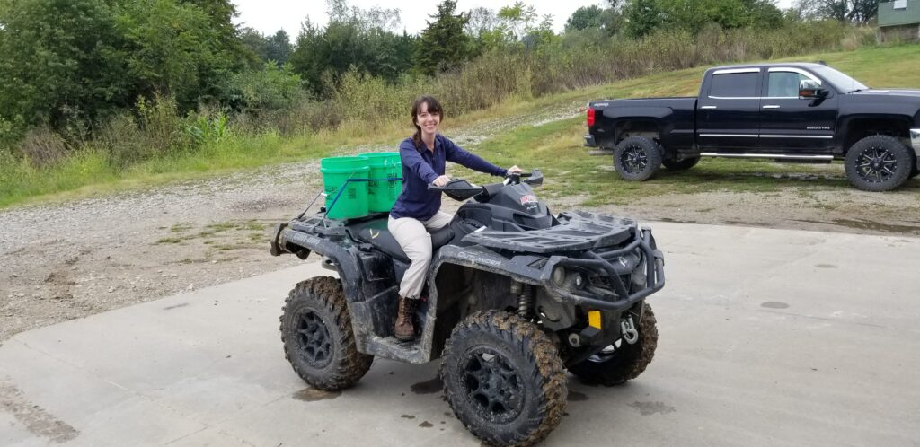 Shannon on an ATV, headed down to the river