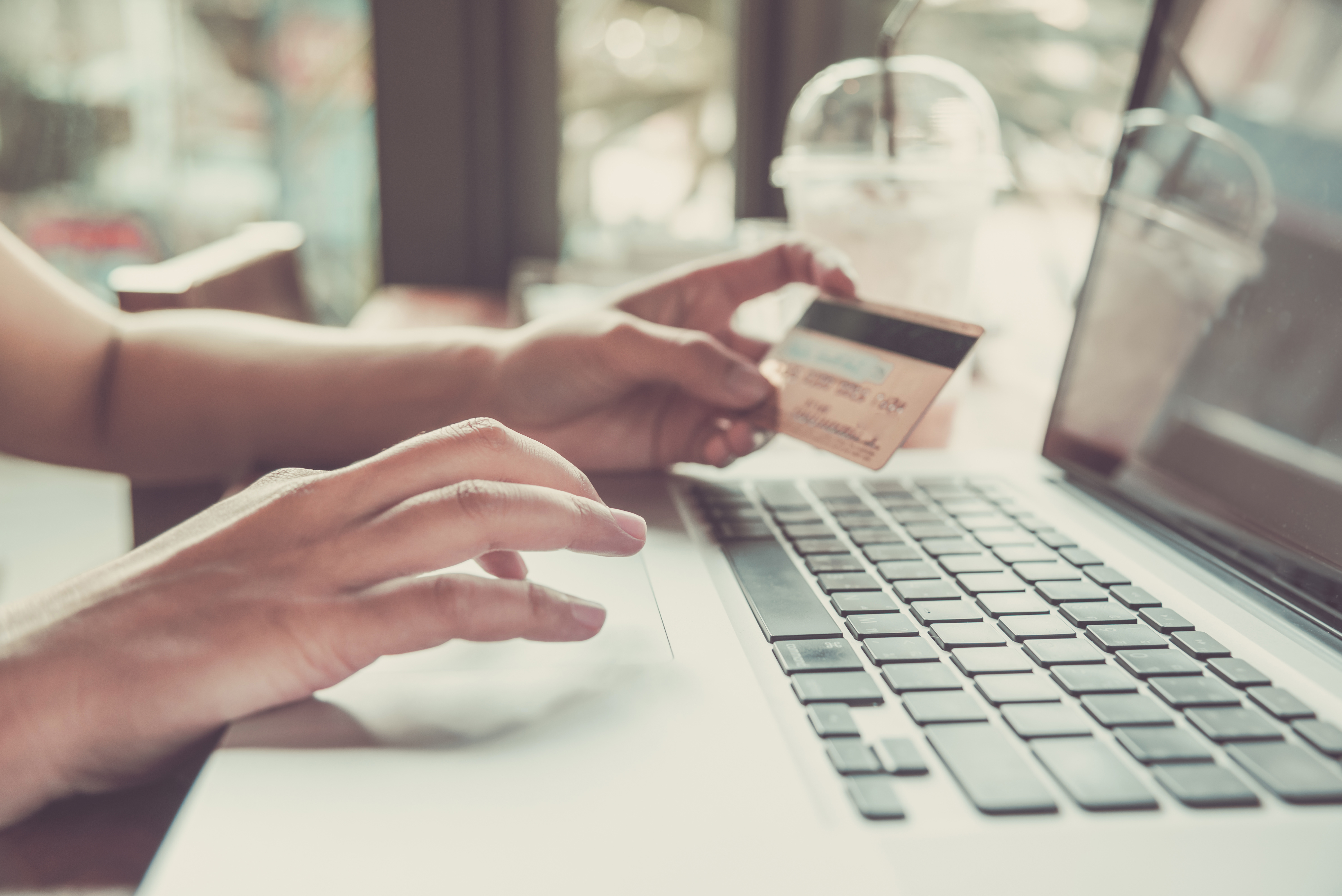 shopping online on computer at coffee shop. (payment concept).