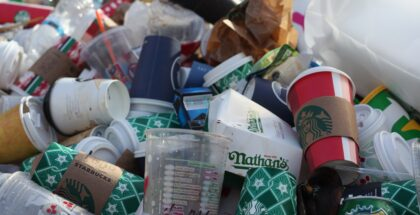 Several single use containers and cups thrown in garbage