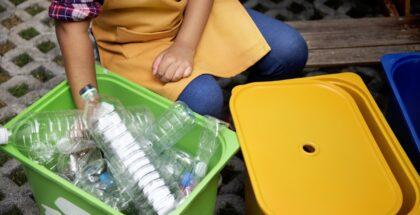 Closeup of hands separating plastic bottles