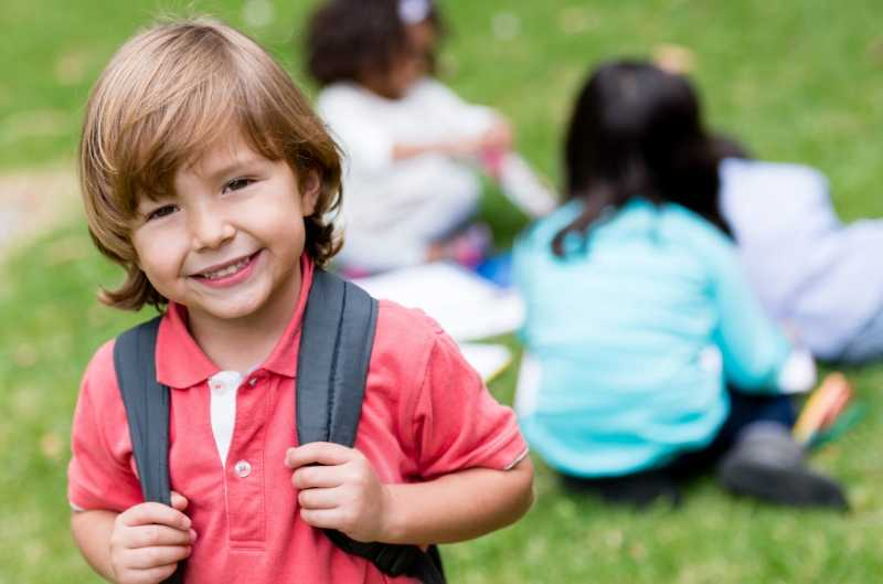 Young boy with backpack