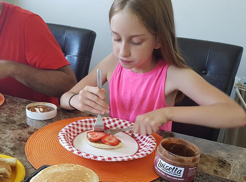 littlegirl eating pancakes with luisella and strawberries