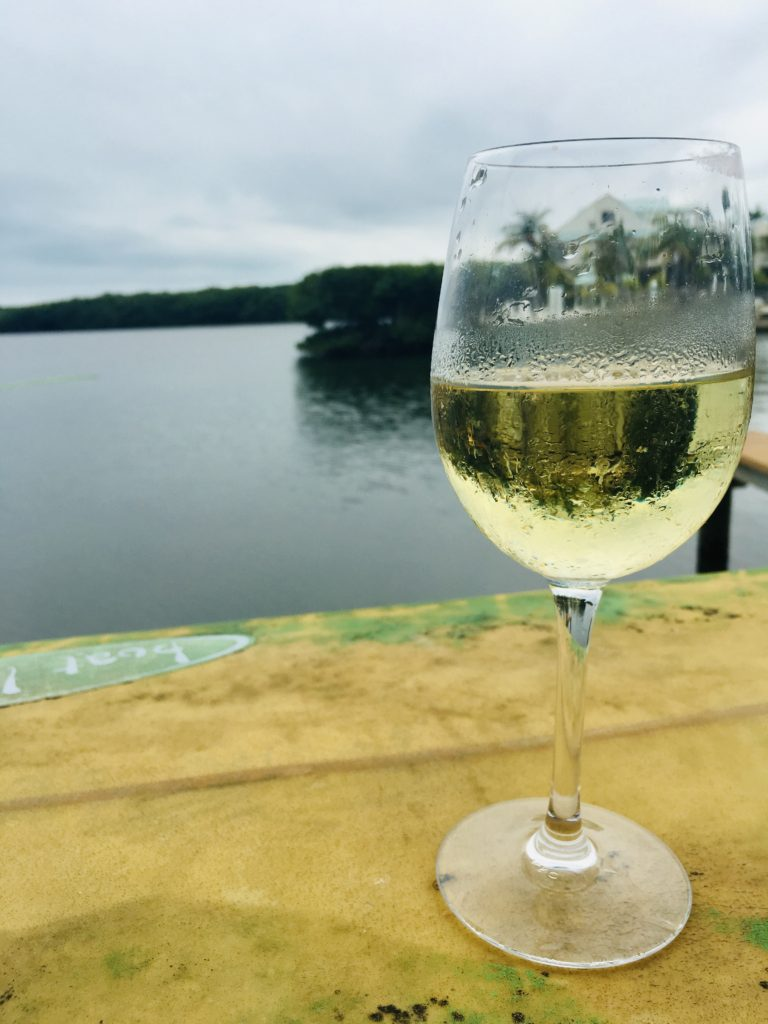 glass of wine, great paired with stone crabs