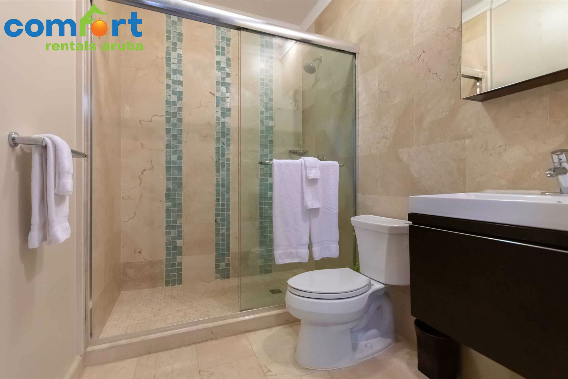 En-suite master bathroom with a shower