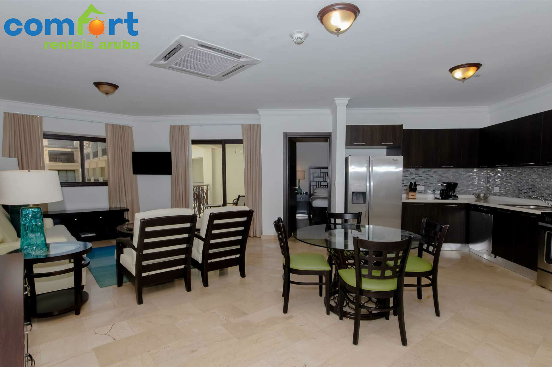 The condo features an open plan living area that will make you feel right at home