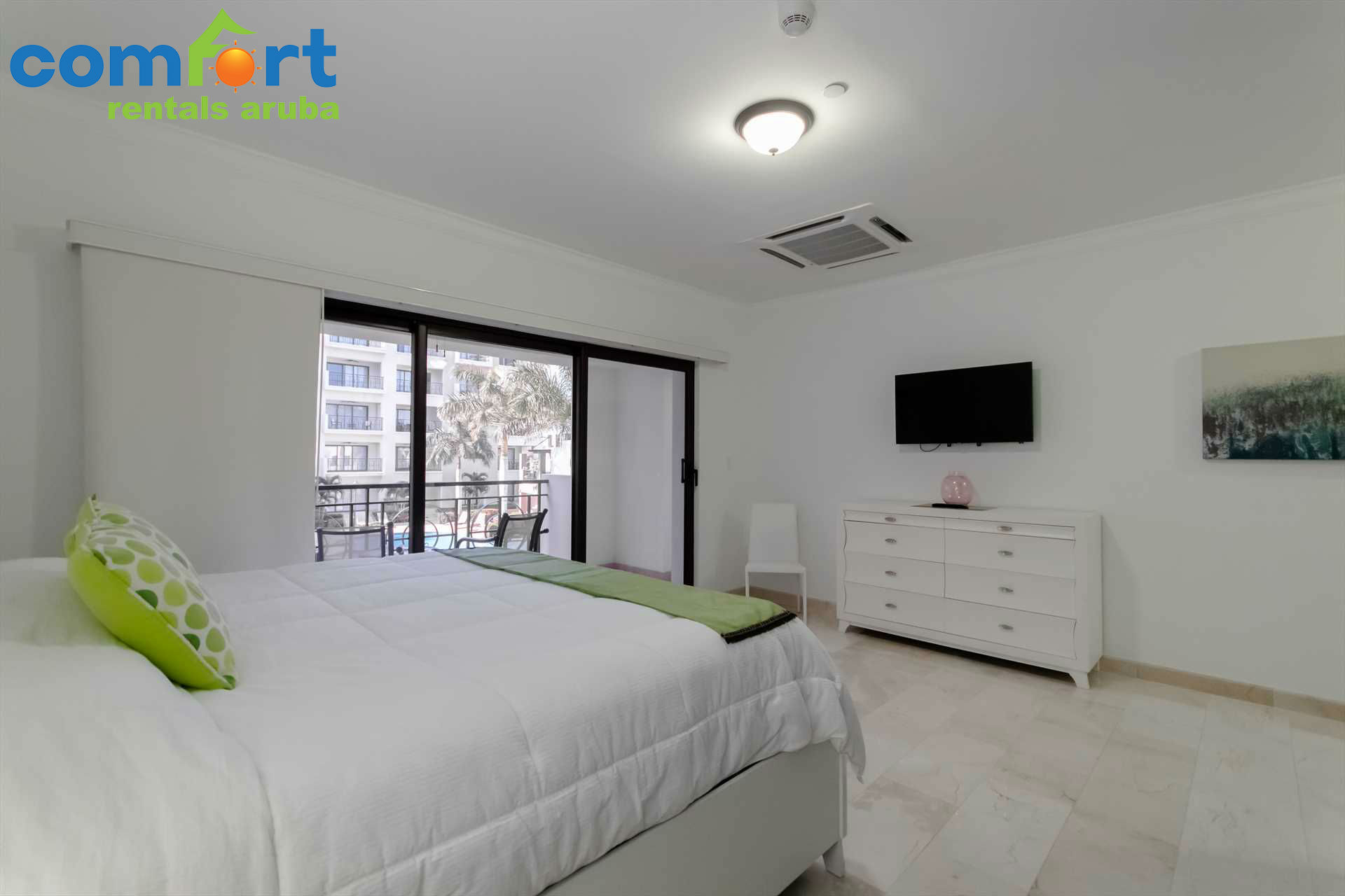 The master bedroom features tinted glass doors for added privacy