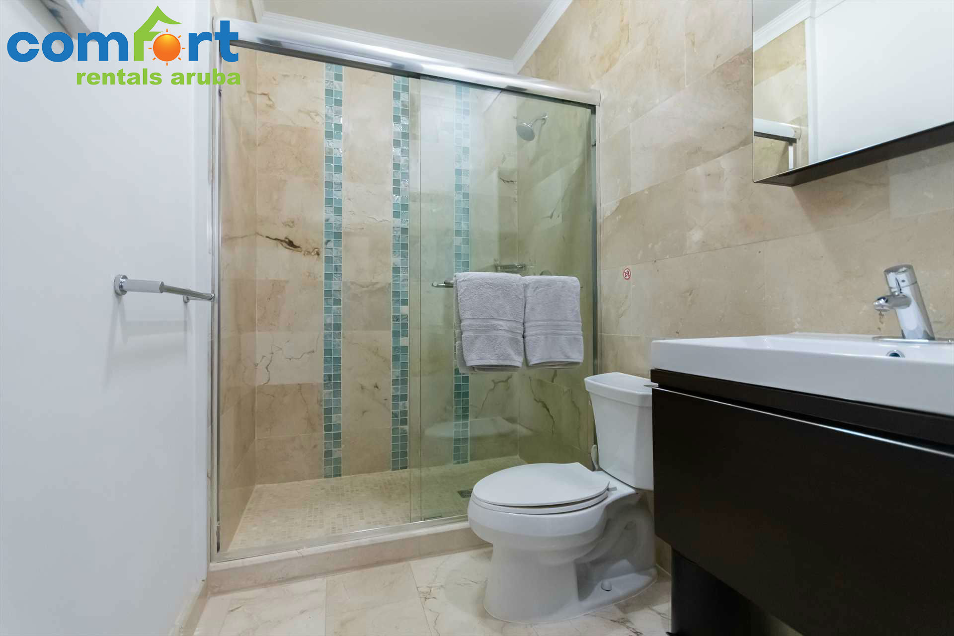 A second separate bathroom with shower