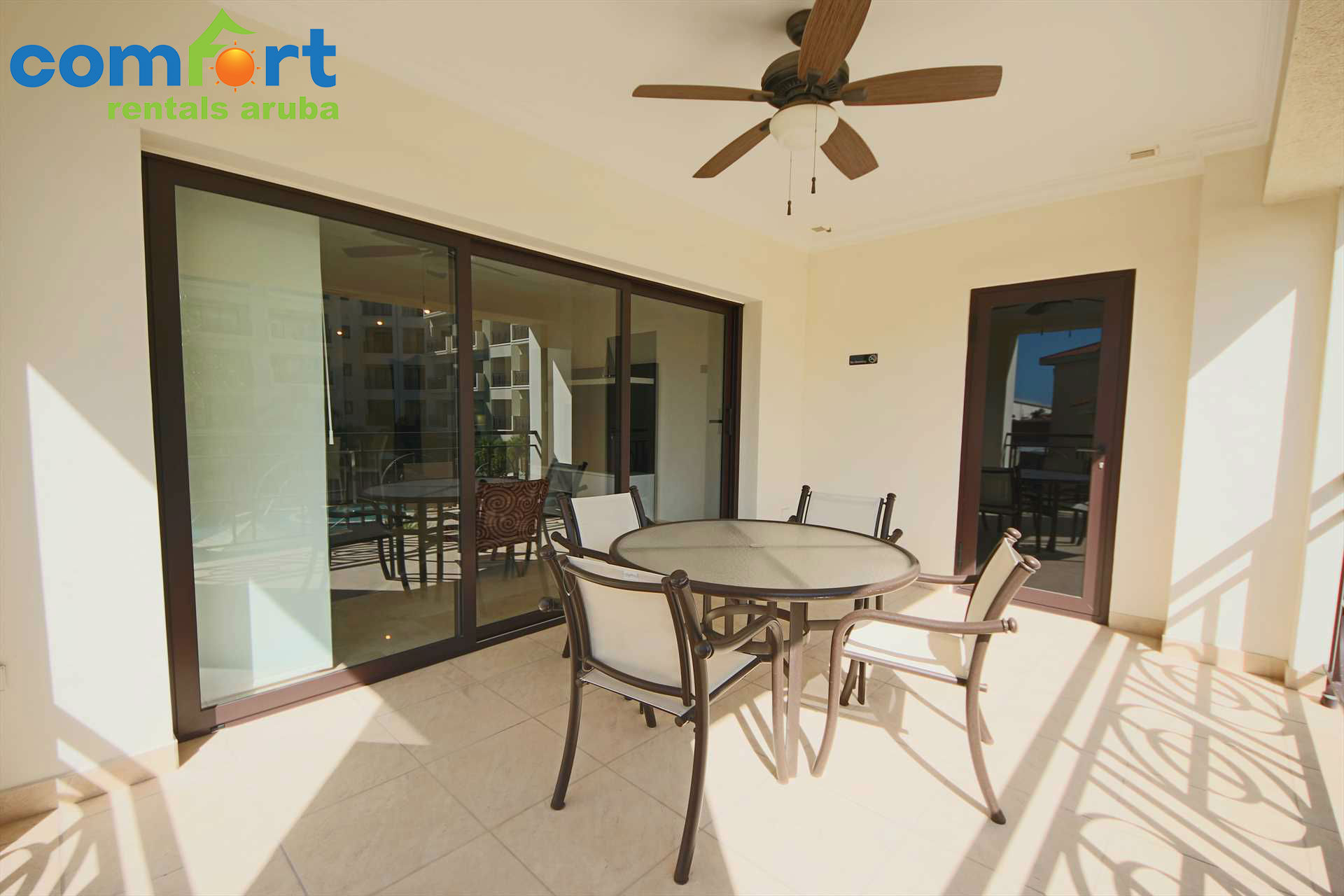 Step into your balcony with outdoor furniture and a beautiful pool view!