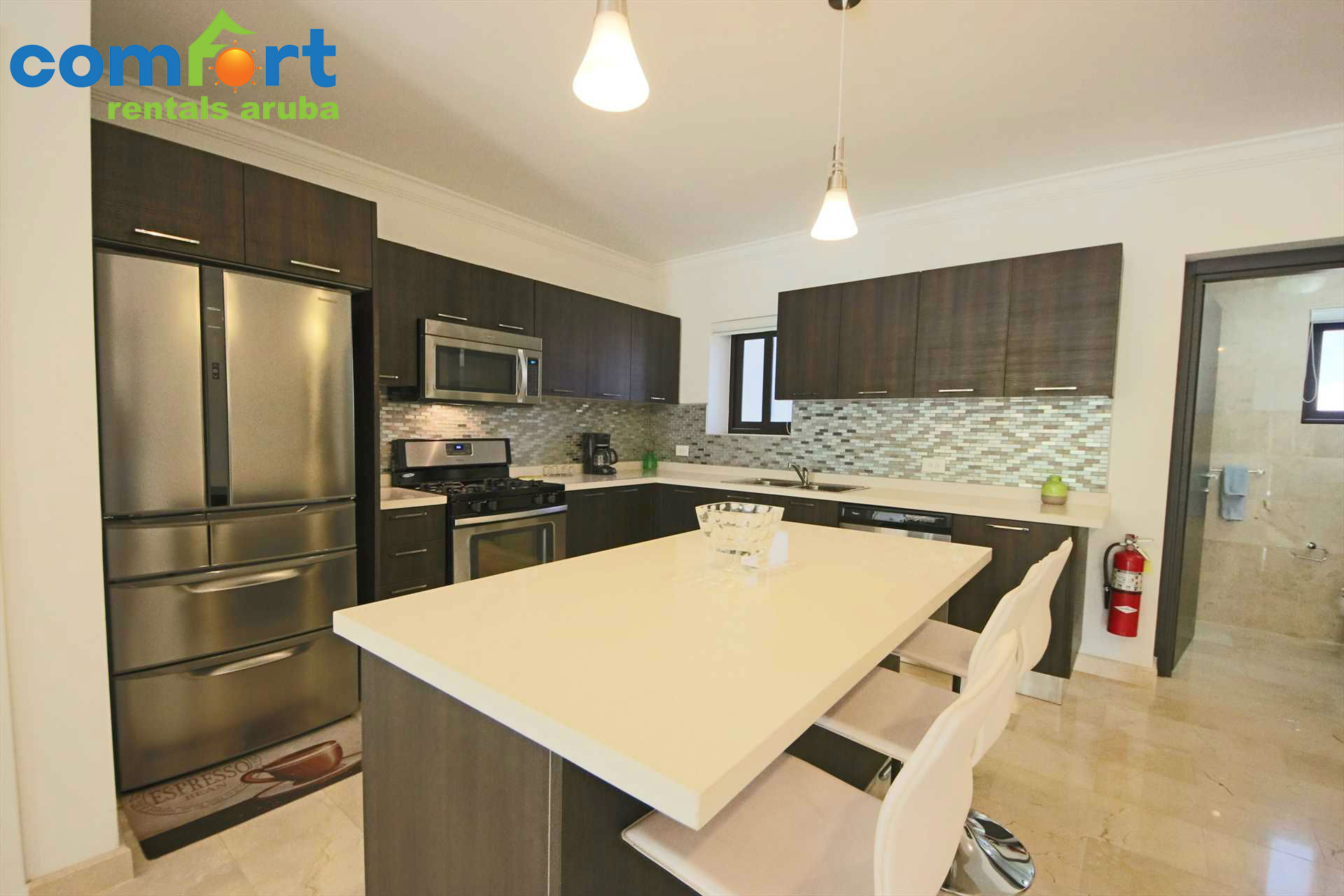 Open kitchen area with 3-seat bar-table
